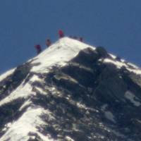 High-climbers: Yuichiro Miura and his party reach the summit of Mount Everest on Thursday morning. | KYODO