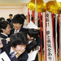 Happy days: Students at Clark Memorial International High School, where Yuichiro Miura, 80, serves as principal, celebrate Thursday at the school's Tokyo campus in Shinjuku Ward upon learning he had reached the summit of Mount Everest. | KYODO