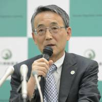 Finding fault: Nuclear Regulation Authority Chairman Shunichi Tanaka addresses reporters Wednesday after the watchdog fully backed a report that said reactor 2 at the Tsuruga nuclear plant in Fukui Prefecture is sitting on top of an active geological fault. | KYODO