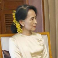Wholehearted support: Myanmar opposition leader and Nobel laureate Aung San Suu Kyi meets with visiting Prime Minister Shinzo Abe in Yangon on Saturday. | KYODO