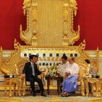 Bearing gifts: Prime Minister Shinzo Abe speaks with Myanmar President Thein Sein at the Presidential Palace in Naypyitaw on Sunday. | AFP-JIJI