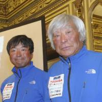 Three times lucky: Eighty-year-old alpinist Yuichiro Miura attends a news conference in Katmandu on Sunday with his son, Gota, after becoming the oldest person to scale Mount Everest last week. | AFP-JIJI