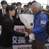 Mountain man: Japanese climber Yuichiro Miura, who became the oldest person to scale Mount Everest, is welcomed by students from Clark Memorial International High School, where he serves as principal, upon his arrival at Tokyo's Haneda airport Wednesday. | AP