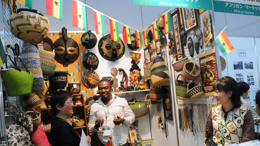 Out of Africa: Visitors view masks, food and baskets at the Ghanaian booth Thursday during African Fair 2013 in Yokohama.