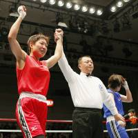 Winner: Comedian Shizuyo Yamasaki defeats a Taiwanese boxer at the first Challenge Match competition for nonprofessional female boxers in April in Tokyo. | KYODO