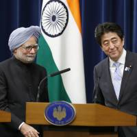 Show of solidarity: Prime Minister Shinzo Abe escorts his Indian counterpart, Manmohan Singh, after a joint news conference Wednesday at the Prime Minister's Office in Tokyo.  | AP