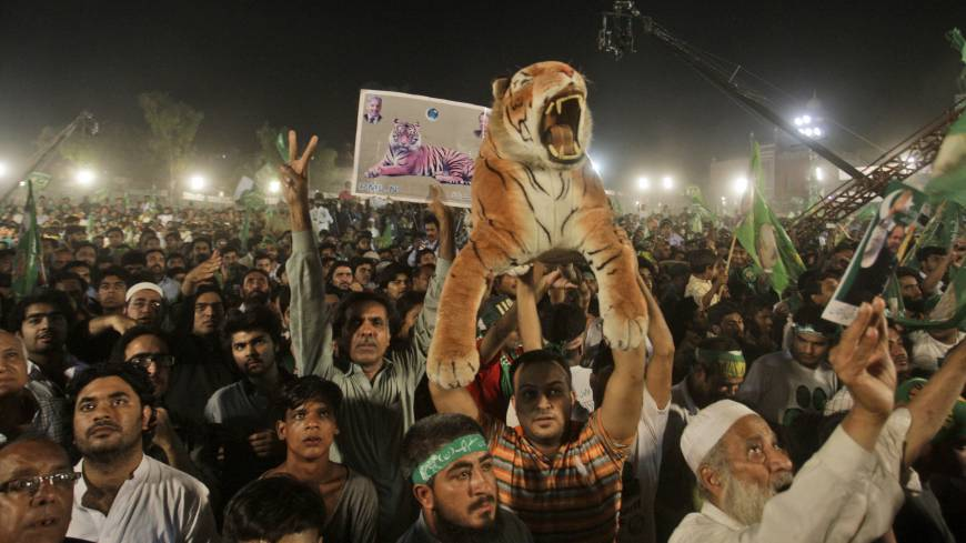 Roar deal: Supporters of former Pakistani Prime Minister Nawaz Sharif listen to him delivering a speech during an election campaign rally in Lahore, Pakistan, on Thursday.