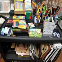 Write stuff: A wagon sports stationery items, including pencils, pens, crayons, erasers and notebooks, at bunbougu cafe.    | YOSHIAKI MIURA