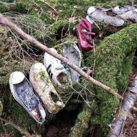 Remnants: Shoes for a man, a woman and a child left in the Aokigahara Jukai forest on the flank of Mount Fuji in Yamanashi Prefecture. The name in part translates as 'Sea of Trees,' though with good reason it is often referred to as 'Suicide Forest.' | ROB GILHOOLY