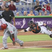 Cards eke out win over Mets