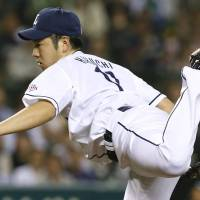 Hear me roar: Seibu's Yusei Kikuchi delivers a pitch during the Lions' 5-1 win over the Tigers on Monday. | KYODO