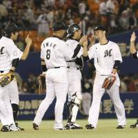 Weekend fun: The Chiba Lotte Marines relish their 4-3 victory over the Yomiuri Giants on Friday night in interleague action at QVC Marine Stadium. | KYODO
