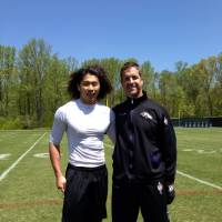 Direct hotline: Takashi Kurihara poses for a photo with Ravens head coach John Harbaugh during the team's minicamp in Owings Mills, Maryland, earlier this month. | TAKASHI KURIHARA