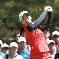 Solid afternoon: Sakura Yonamine ends a two-year title drought by winning the Cyber Agent Ladies with a three-round 206 on Sunday in Ichihara, Chiba Prefecture. Yonamine won the tournament by two strokes. | KYODO