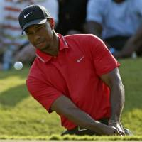 Tiger claims The Players title, laughs last in spat with Garcia