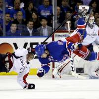 Stepan, Asham rescue Rangers in third against Capitals
