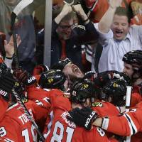 Chicago ousts Detroit in OT