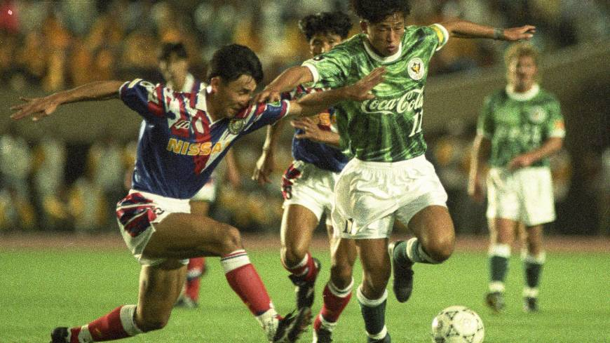 Step back in time: Verdy Kawasaki's Kazuyoshi Miura (right) takes on the Yokohama Marinos defense during the opening match of the J. League's inaugural season on May 15, 1993.