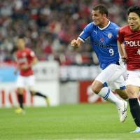 Big change: Defender Ryota Moriwaki (right) moved to Urawa Reds this season following a lengthy career with Sanfrecce Hiroshima where he appeared in 141 matches. | AP