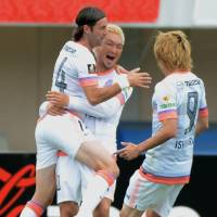 Impressive strike: Sanfrecce's Yojiro Takahagi (center) celebrates with teammates after scoring against Shonan Bellmare in the first half on Saturday afternoon. Hiroshima won 2-0. | KYODO