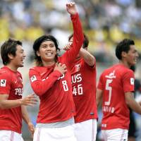 Goal rush: Yosuke Kashiwagi celebrates after scoring his second goal in Urawa Reds' 6-2 win over Kashiwa Reysol at National Stadium on Sunday. | KYODO