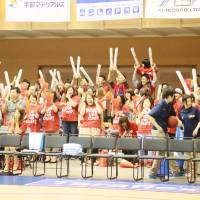 Thrill of victory: Rizing supporters celebrate after the team eliminated Shimane from the playoffs. Fukuoka advanced to the Final Four for the first time since 2008. | HIROAKI SHUTO