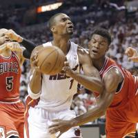 Wade, Heat put away Bulls in five