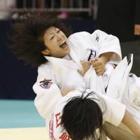 Get down: Haruna Asami (top) competes with Tamami Yamazaki during the All-Japan invitational weight class championships on Saturday. | KYODO