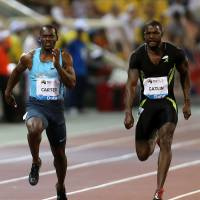 Gatlin, Reese lead way as U.S. has banner night in Doha