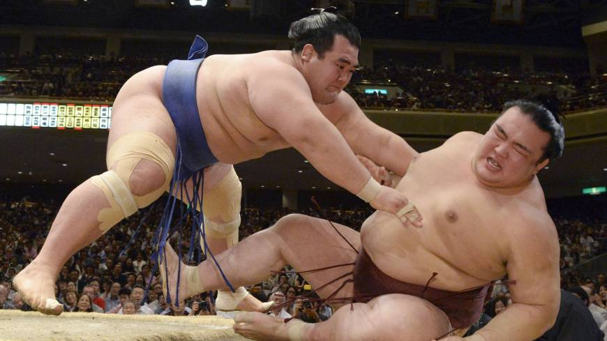 End of the line: Kisenosato (right) loses to Kotoshogiku at the Summer Grand Sumo Tournament on Sunday.
