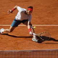 Nadal rallies past Ferrer in Madrid; Serena, Sharapova advance