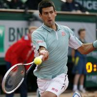 Djokovic wins opener after rain delay