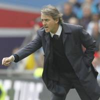 Manchester City fires Mancini with four years left on contract