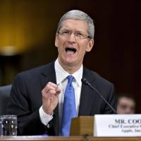 Apple CEO Cook grilled in Congress on offshore taxes