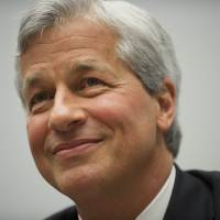 JPMorgan chief keeps twin posts