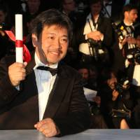 "Savoring the moment: Japanese director Hirokazu Koreeda is seen after being awarded the Prix du Jury (Jury's Prize) for his film ""Like Father, Like Son"" at the 66th Cannes Film Festival in Cannes, France, on Sunday. 