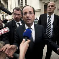 The love affair is over: Then French President-elect Francois Hollande stops to speak to the media as he greets supporters outside his campaign headquarters in Paris just before assuming office in May 2012. Hollande promised a 75 percent tax on income over ?1 million ($1.3 million) and higher taxes on large companies during the presidential campaign. | BLOOMBERG