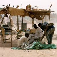 Darfur gold mine collapse kills 100, traps rescuers