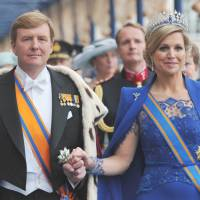 Sins of her father: Dutch King Willem-Alexander and Queen Maxima leave Nieuwe Kerk church in Amsterdam following his investiture on April 30. | AFP-JIJI