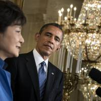 United front: U.S. President Barack Obama listens as Park Geun Hye, South Korea's first female president, fields questions during a joint news conference in Washington on Tuesday. | AFP-JIJI