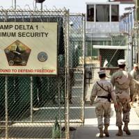 Indefinite detention: Military guards are seen walking at Camp Delta military prison at the U.S. naval base in Guantanamo Bay, Cuba, in 2006. | AP