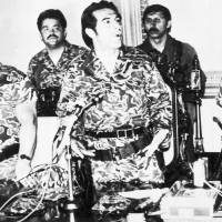 Military rule: Gen. Efrain Rios Montt, flanked by Gen. Horacio Maldonado Shad (left) and Col. Luis Frandisco Gordillo (right), announces the formation of a military junta following the overthrow of Gen. Fernando Romeo Lucas Garcia's rightwing government in Guatemala City in March 1982. Rios Montt held absolute power for just over a year. | AP