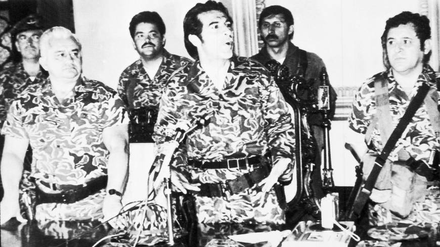 Military rule: Gen. Efrain Rios Montt, flanked by Gen. Horacio Maldonado Shad (left) and Col. Luis Frandisco Gordillo (right), announces the formation of a military junta following the overthrow of Gen. Fernando Romeo Lucas Garcia's rightwing government in Guatemala City in March 1982. Rios Montt held absolute power for just over a year.