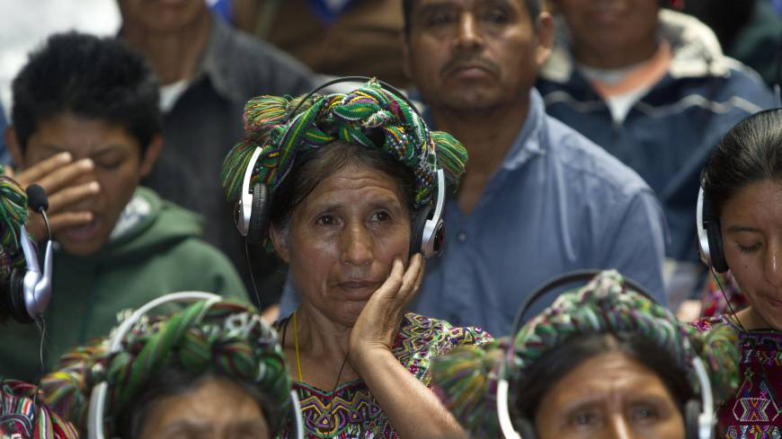 Survivors testify: An Ixil Indian woman, a relative of a civil war victim, uses earphones to listen to translations at the trial of Efrain Rios Montt in Guatemala City on Thursday.