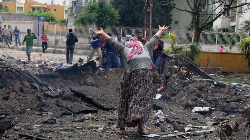 Grief: A woman cries at the site of a massive car bomb explosion in the town of Reyhanli, Turkey, on Saturday.
