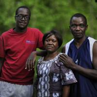 American dreamers: Joseph Wangota (right) appears with his wife, Annaciata, and 16-year-old son, Calvin, at their home in Chantilly, Virginia. The family came to the United States 13 years ago from Uganda using the green card lottery program. | THE WASHINGTON POST