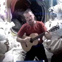 Star man: Chris Hadfield records the first music video from space on Sunday. | AP