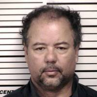 Warped: Ariel Castro, 52, is booked by police on May 9 in Cleveland, Ohio. Castro, a former school bus driver, is accused of imprisoning three young women, using them as sex slaves and beating them repeatedly over a decade at his Cleveland home. | AP