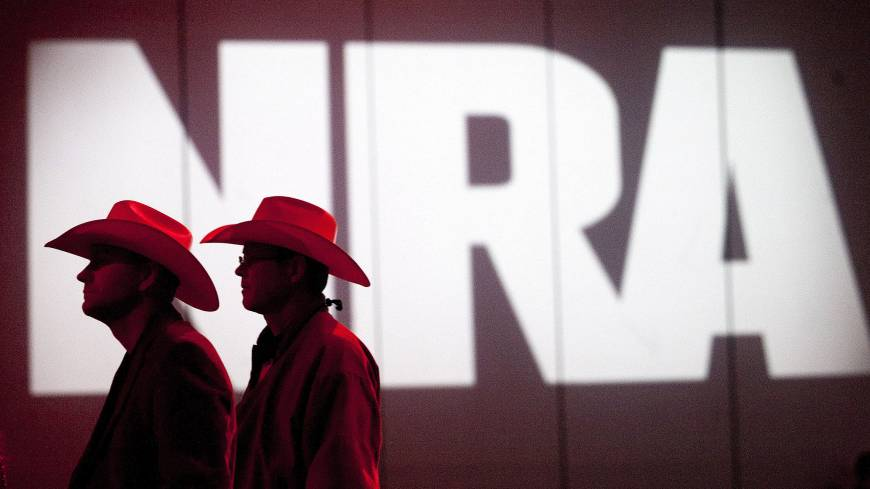 Name of the game: National Rifle Association members listen to speakers during the Annual Meeting of Members on May 4 in Houston.