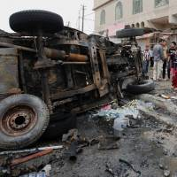 Scores die in Iraqi bomb attacks
